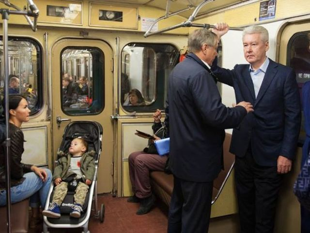 (Moscow Mayor Sergei Sobyanin, standing to the right next to the door.)