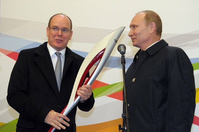 Mr. Putin presented one of the Olympic torches to Prince Albert II of Monaco.