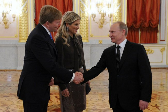 President Putin greets Netherlands King Willem-Alexander. height=331