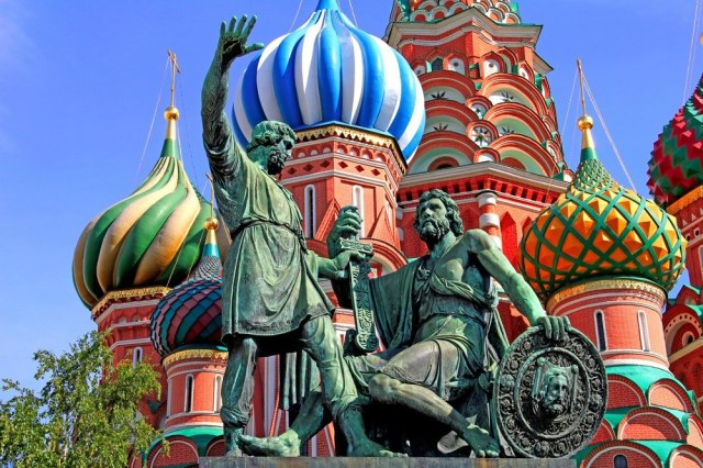 The statue that sits in front of St. Basil's Cathedral are of Kuzma Minin and Dmitry Pozharsky, the two citizens who led the revolt against the Polish forces in the Kremlin.