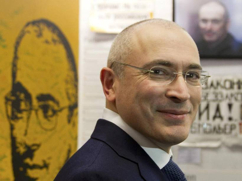 Smiling after release, Mikhail Khodorkovsky at the Adlon Hotel in Berlin.