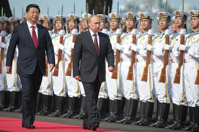 Presidents Xi Jinping and Putin inspect Chinese Naval forces.