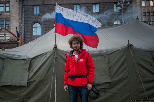 "Media tent on Maidan. Photographer Ilya Varlamov planted a Russian flag inscribed ""I am Maidan."""