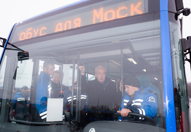 "Moscow Mayor Sergei Sobyanin inspects new ""kneeling"" buses, designed for easier passenger access."